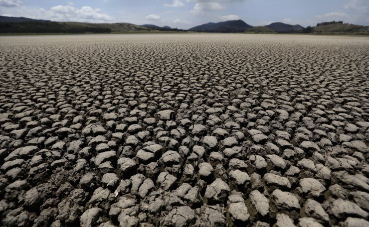 In this Wednesday, Feb. 17, 2021 file photo, the lakebed of Suesca lagoon sits dry and cracked, in Suesca, Colombia, after years of very little rainfall. AP
