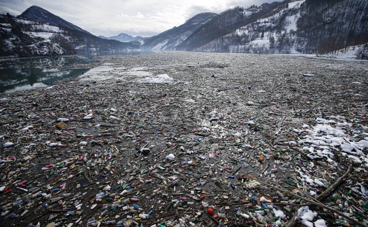 Plastic bottles and other garbage floats in the Potpecko lake near Priboj, in southwest Serbia, on Friday, Jan. 22, 2021. AP
