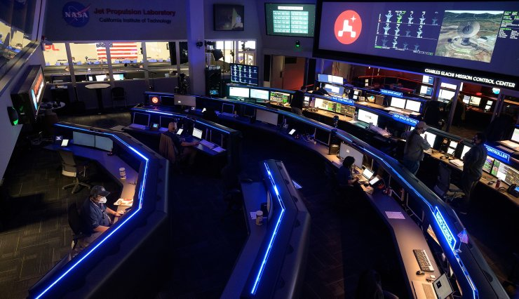 Members of NASA?s Perseverance Mars rover team study data on monitors in mission control at NASA's Jet Propulsion Laboratory in Pasadena, California, U.S. February 18, 2021. REUTERS/NASA