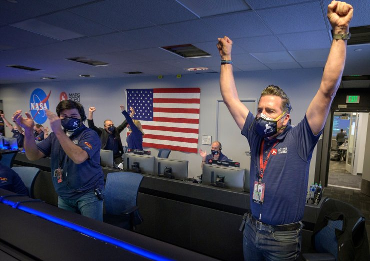 A handout photo made available by NASA shows Members of NASA's Perseverance rover team react in mission control after receiving confirmation the spacecraft successfully touched down on Mars, at NASA's Jet Propulsion Laboratory in Pasadena, California, USA, 18 February 2021.  EPA/NASA