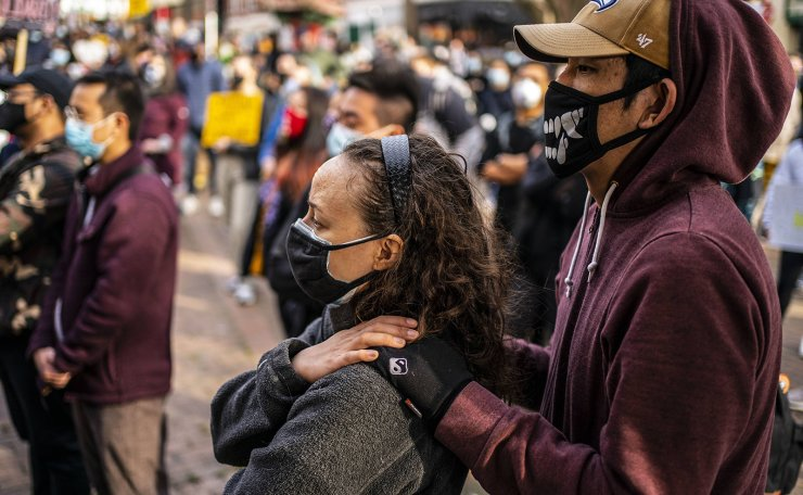 Demonstrators gather in the Chinatown-International District during a 'We Are Not Silent' rally and march against anti-Asian hate and bias on March 13, 2021 in Seattle, Washington. AFP