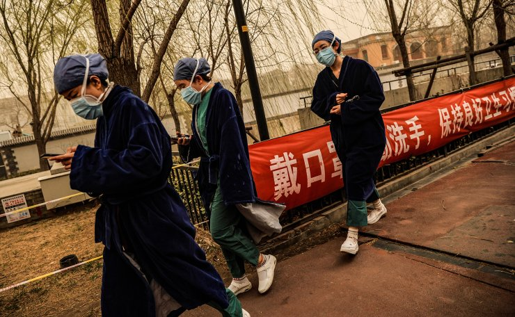 <span>Nurses go about their day during morning rush hour as Beijing, China, is hit by a sandstorm, March 15, 2021. Reuters</span><br /><br />