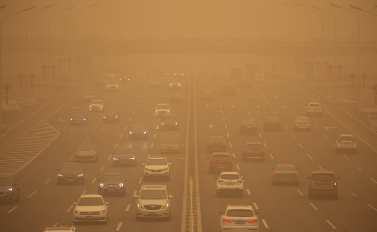 Cars are driven along an expressway amid a sandstorm during the morning rush hour in Beijing, Monday, March 15, 2021. AP