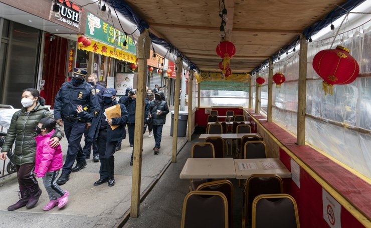 New York Police Department officers with the Community Affairs Rapid Response Unit go on a community outreach patrol in the Chinatown neighborhood of New York, Wednesday, March 17, 2021. AP