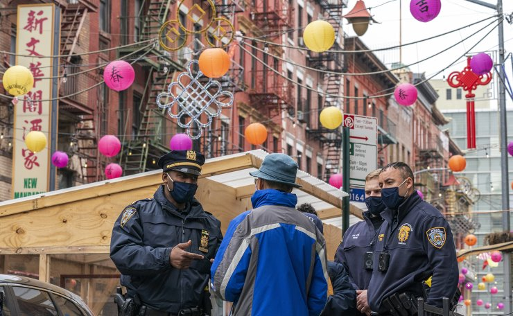 Capt. Tarik Sheppard, left, Commander of the New York Police Department Community Affairs Rapid Response Unit speaks to a resident while on a community outreach patrol in the Chinatown neighborhood of New York, Wednesday, March 17, 2021. AP
