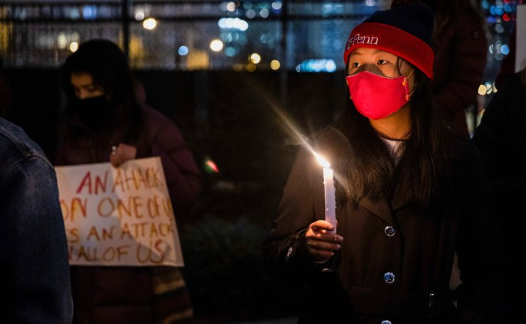 People attend a vigil in solidarity with the Asian American community after increased attacks on the community since the onset of the coronavirus pandemic a year ago, in Philadelphia, Pennsylvania, U.S., March 17, 2021.  REUTERS