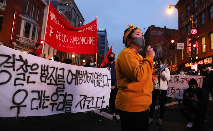 Activists participate in a vigil in response to the Atlanta spa shootings March 17, 2021 in the Chinatown area of Washington, DC. A gunman opened fire in three spas in the Atlanta, Georgia area, the day before killing eight people, including six women of Asian descent. AFP