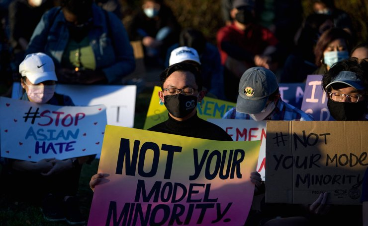Attendees close their eyes during a Stop Asian Hate rally at Discovery Green in downtown Houston, Texas on March 20, 2021. AFP