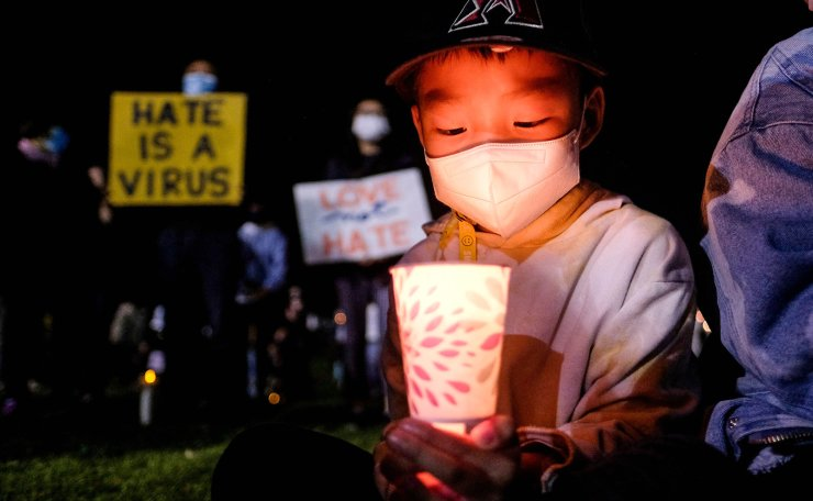 Lael Choi, 7, holding a candle takes part in a candlelight vigil in standing up against Asian American Pacific Islander (AAPI) hate and violence, at Almansor Park in Alhambra, California, on March 20, 2021. AFP