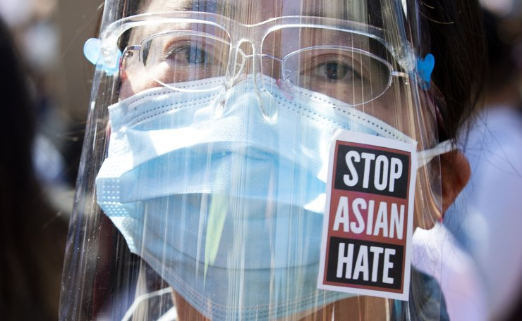 A person with a sticker that reads 'Stop Asian Hate' attends a rally with hundreds of people to voice opposition toward hatred against Asians, at McPherson Square in Washington, DC, USA, 21 March 2021. EPA