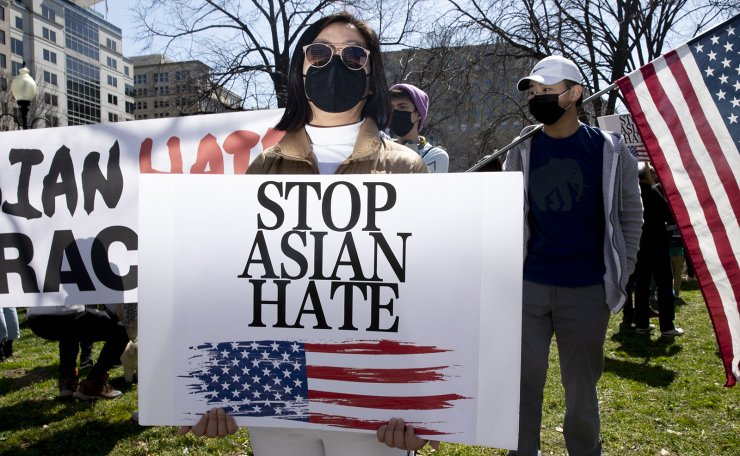 A person joins hundreds of people gathering at a rally to voice opposition toward hatred against Asians, at McPherson Square in Washington, DC, USA, 21 March 2021. EPA