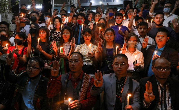 Myanmar citizens living in India and members of Mizo Zirlai Pawl (MZP), a student organisation from India's Mizoram state, hold a candle vigil to pay tribute to people who died in Myanmar after the military coup, in New Delhi, India, March 23, 2021. REUTERS