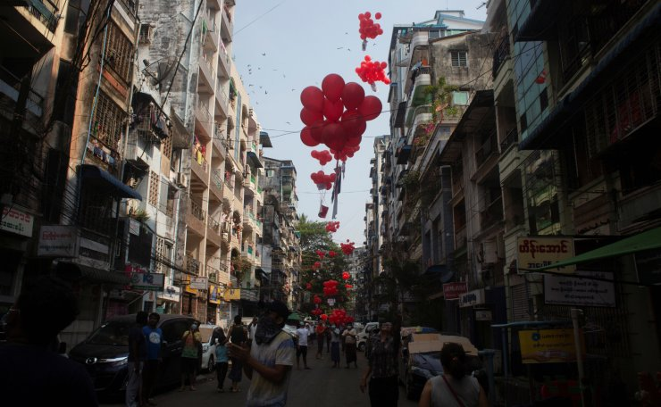 Protesters release red balloons during a protest against the military coup in Yangon, Myanmar, March 24, 2021. REUTERS