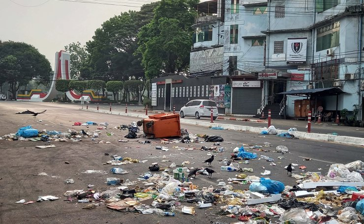 Protesters throw the garbage on the road as a protest against the military coup in Yangon, Myanmar, 30 March 2021. Anti-coup protests continued despite the intensifying violent crackdowns on demonstrators by security forces.  EPA