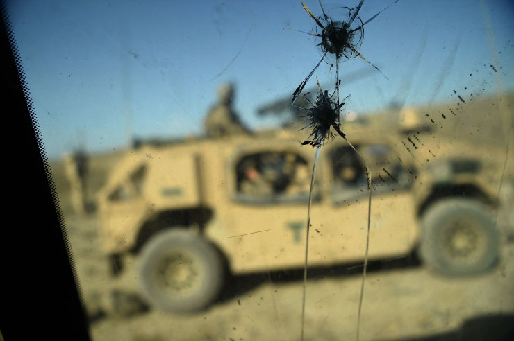 In this file photo taken on July 7, 2018, US Army soldiers from NATO are seen through a cracked window of an armed vehicle in a checkpoint during a patrol against Islamic State militants at the Deh Bala district in the eastern province of Nangarhar Province. AFP