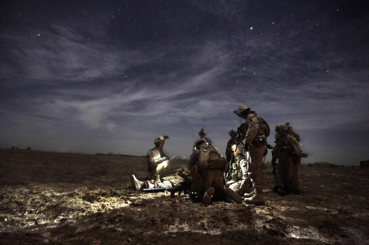 In this file photo US Marines with 1/3 Charlie Company treat Lance Corporal Kris Mottley (21) from Pensylvania as they wait for a MEDEVAC helicopter, after their MRAP vehicle was hit by an Improvised Explosive Device (IED) in Trikh Nawar on the north-eastern outskirts of Marjah late February 23, 2010. AFP