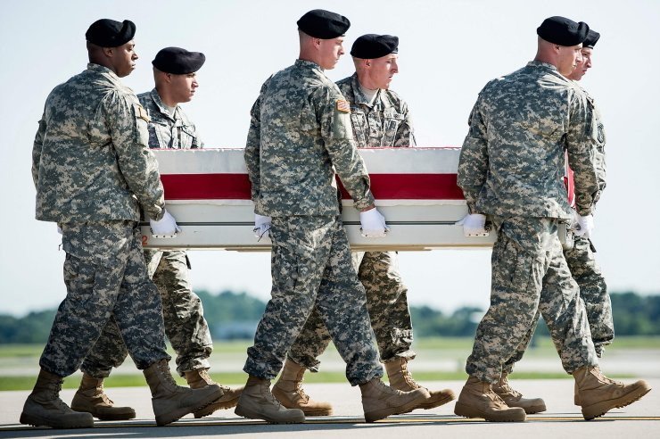 In this file photo a US Army carry team moves a transfer case with the remains of US Army Maj. Gen. Harold J. Greene from a C-17 cargo plane during a dignified transfer at Dover Air Force Base August 7, 2014 in Delaware. AFP