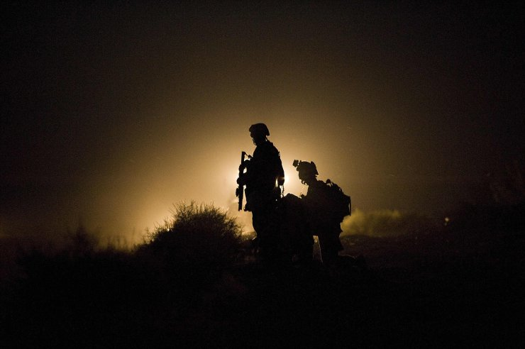 In this file photo US Marines of 1st Combat Engineering Battalion of  2nd Marine Expeditionary Brigade stand guard as the search goes on for missing marines after an Improvised Explosive Device (IED) blast in Garmsir district of Helmand Province on July 13, 2009. AFP