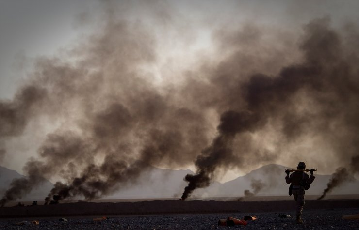 A U.S. Marine walks to pick up food supplies after they were dropped off by small parachutes from a plane outside Forward Operating Base Edi in the Helmand Province of southern Afghanistan on June 9, 2011. AP