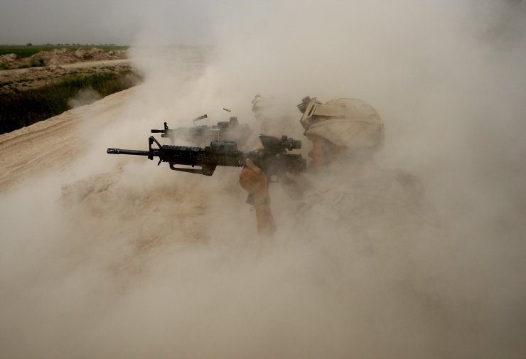 U.S. Marines, from the 24th Marine Expeditionary Unit, return fire on Taliban positions near the town of Garmser in Helmand Province of Afghanistan on May 2, 2008. AP