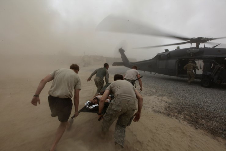 During a rescue mission by a team from a U.S. Air Force Expeditionary Rescue Squadron, army medics carry a wounded Afghan Army soldier to an evacuation helicopter, in Kandahar province, southern Afghanistan, on Aug. 2, 2010. AP