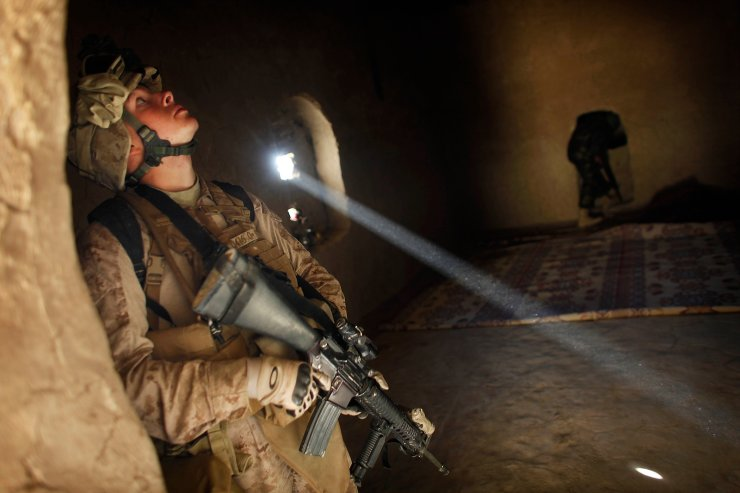 United States Marine LCpl. Franklin Romans of Michigan, from the 2nd Battalion 2nd Marines 'Warlords' searches a house during an operation in the Garmsir district of the volatile Helmand province, southern Afghanistan, on Dec. 23, 2009. AP