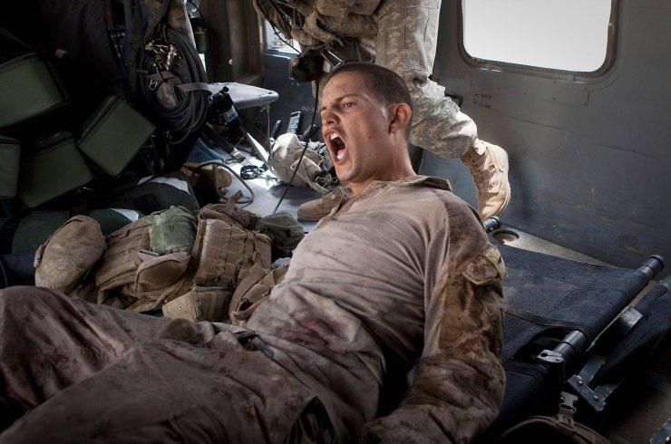 Lance Cpl. Blas Trevino of the 1st Battalion, 5th Marines, shouts out as he is rescued on a medevac helicopter from the U.S. Army's Task Force Lift 'Dust Off', Charlie Company 1-214 Aviation Regiment after he got shot in the stomach outside Sangin, in the Helmand Province of southern Afghanistan on June 11, 2011. AP