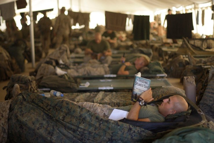 U.S. Marines from the 2nd Marine Expeditionary Brigade rest inside a tent at Camp Leatherneck in Afghanistan's Helmand province on June 9, 2009. AP