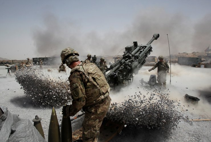 U.S. Army soldiers from the 2nd Platoon, B battery 2-8 field artillery, fire a howitzer artillery piece at Seprwan Ghar forward fire base in Panjwai district, Kandahar province southern Afghanistan, June 12, 2011. REUTERS