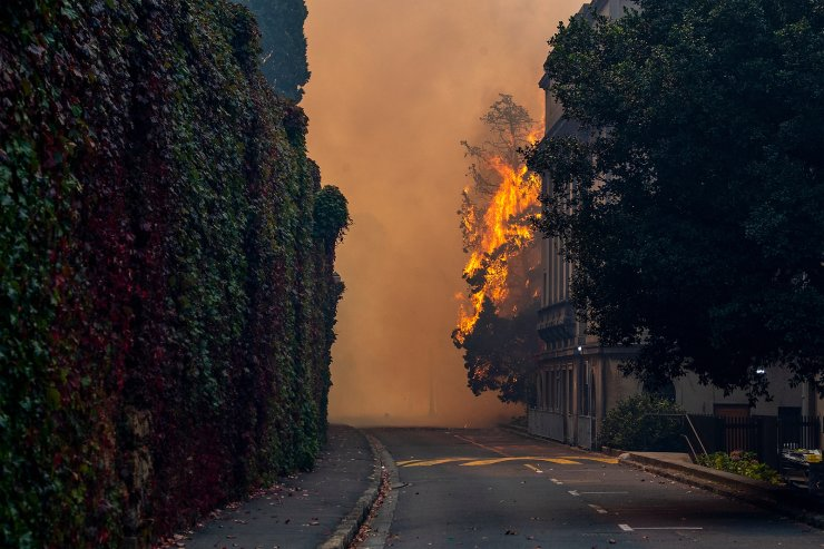A building burns on the campus of the University of Cape, South Africa, Sunday, April 18, 2021. A wildfire raging on the slopes of the mountain forced the evacuation of students from the University. AP