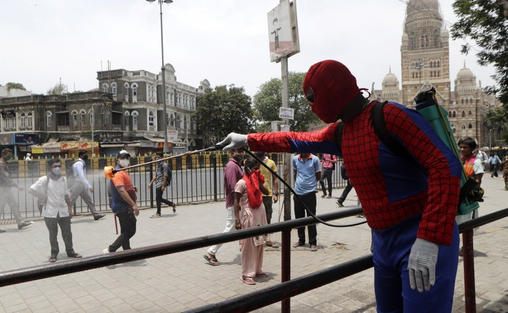 Indian social worker Ashok Kurmi dressed as spider man sanitizes the area around Chhatrapati Shivaji Maharaj train Terminus during a lockdown imposed to curb the spread of COVID-19 in Mumbai, India, Wednesday, April 21, 2021. AP