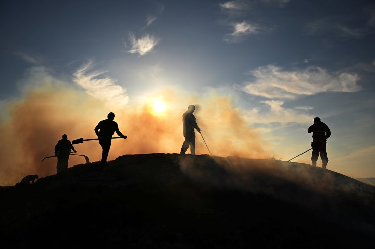 Firefighters work to extinguish a wild gorse fire in the Connemara region of County Galway near Inverin, Ireland, April 25, 2021. REUTERS
