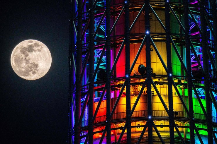 The almost full moon is seen next to the Tokyo Skytree in Tokyo on April 26, 2021. AFP