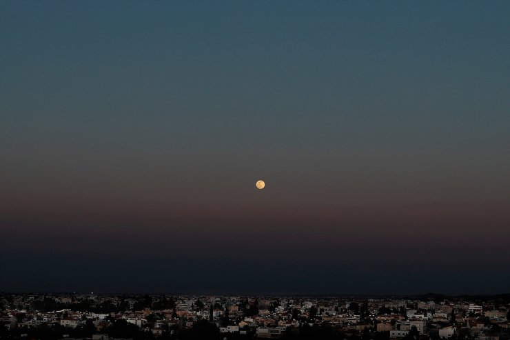 A full moon rises over capital Nicosia in the eastern Mediterranean island of Cyprus, April 26, 2021. This April full moon is called Pink Supermoon. AP