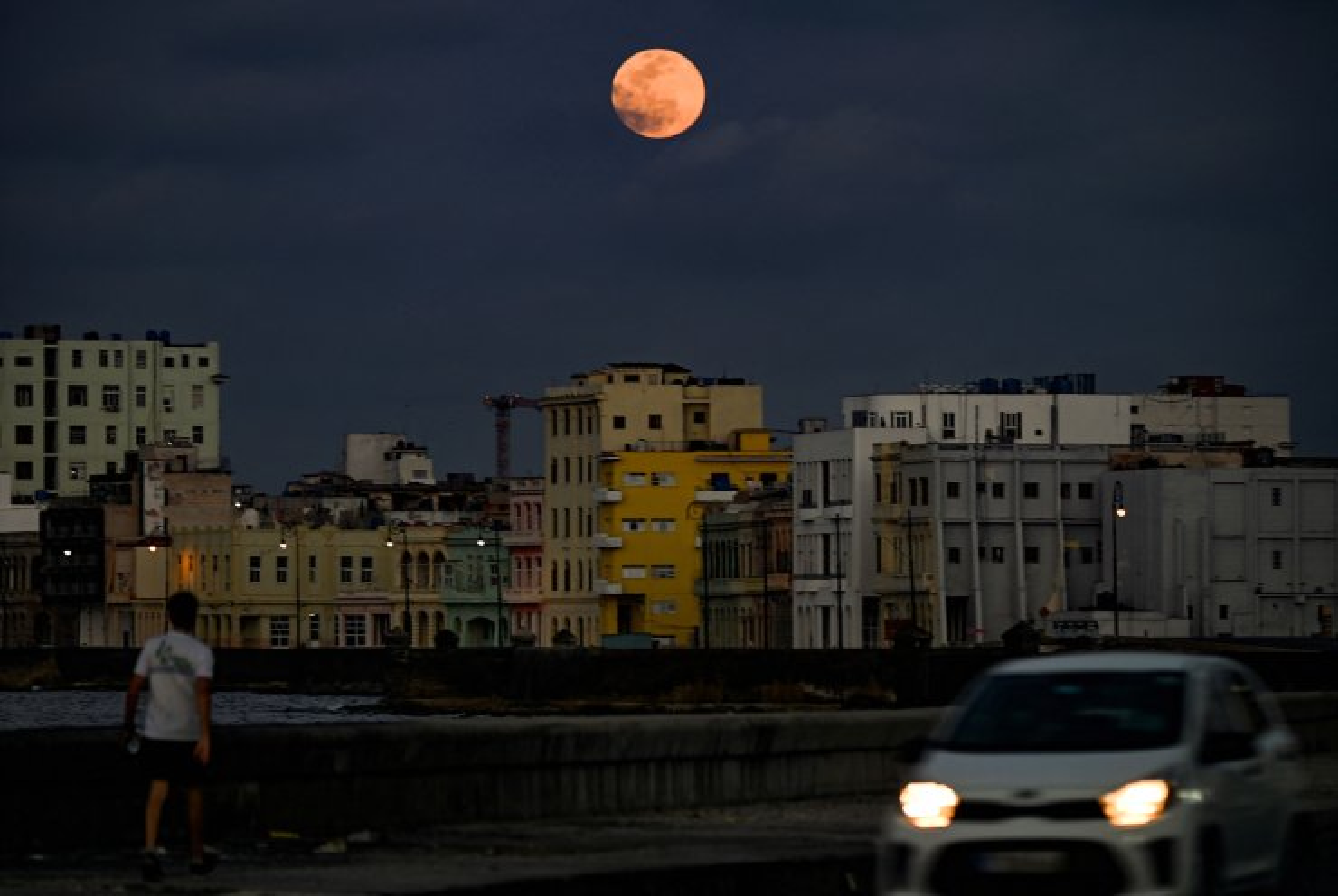 A full 'Super Pink Moon' rises above Havana on April 26, 2021. AFP