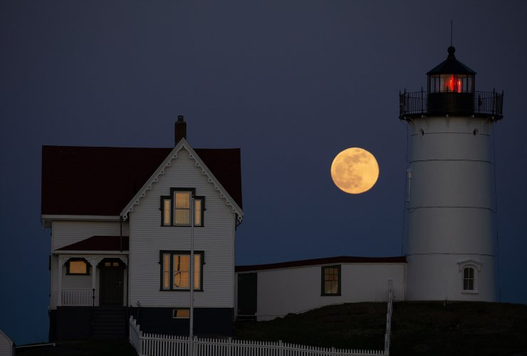 The Super Pink Moon is seen rising behind the Nubble Lighthouse on Cape Neddick, in York, Maine, USA, 26 April 2021. The super full moon is named this way because it is at its closest to earth and thus appears bigger than a normal full moon. Cape Neddick Light Station was dedicated by the US Lighthouse Service and put into use in 1879 and is still in use today. EPA