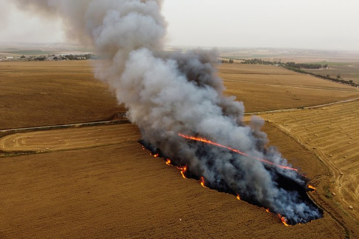 A part of a wheat field goes in flames after Palestinians in Gaza sent incendiary balloons over the border near Nir Am, southern Israel May 9, 2021. Picture taken with a drone. REUTERS