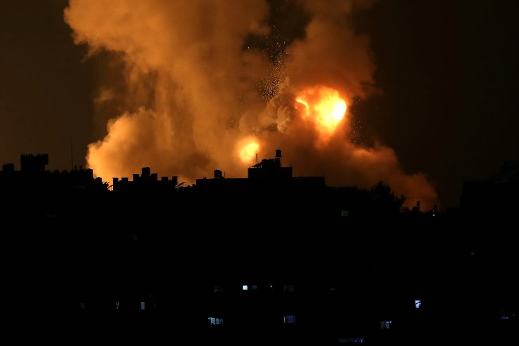 Fire billow from Israeli air strikes in the Gaza Strip, controlled by the Palestinian Islamist movement Hamas, on May 10, 2021. - Israel launched deadly air strikes on Gaza in response to a barrage of rockets fired by the Islamist movement Hamas amid spiralling violence sparked by unrest at Jerusalem's Al-Aqsa Mosque compound. AFP