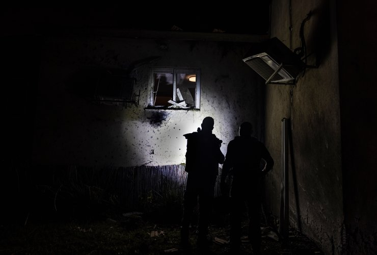 Israeli police inspect damage to a house hit by a rocker fired from the Gaza Strip, at a kibbutz near the Israel and Gaza border, Tuesday, May 11, 2021. AP