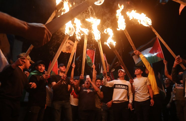 Palestinians stage a protest in solidarity with Palestinian residents of East Jerusalem in the city center of the West Bank city of Hebron, 10 May 2021. EPA