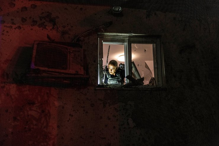 Israeli police inspect damage to a house hit by a rocket fired from the Gaza Strip, at a kibbutz near the Israel-Gaza border, Tuesday, May 11, 2021. AP