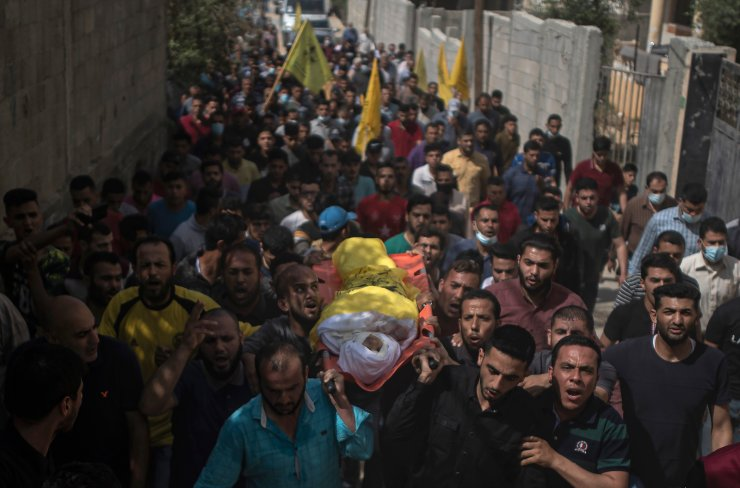 Palestinian mourners carry the body of 11-year-old Hussain Hamad, who was killed by an explosion during the ongoing conflict between Israel and Hamas, during his funeral in Beit Hanoun, northern Gaza Strip, Tuesday, May 11, 2021. AP