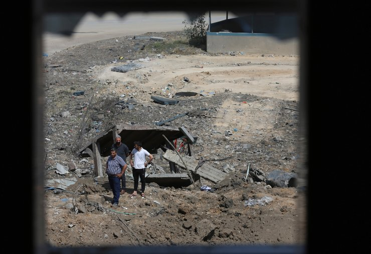 Palestinians inspect the rubble of Ice factory and mechanic garages destroyed by Israeli airstrikes, in Gaza City, Tuesday, May 11, 2021. AP