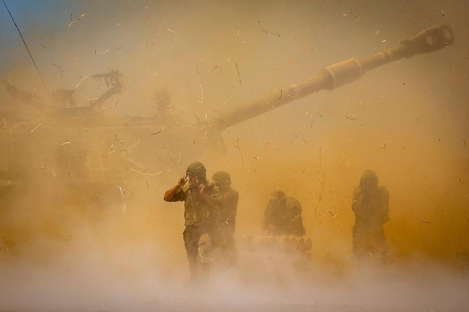 An Israeli artillery unit fires toward targets in Gaza Strip, at the Israeli Gaza border, Wednesday, May 12, 2021. AP