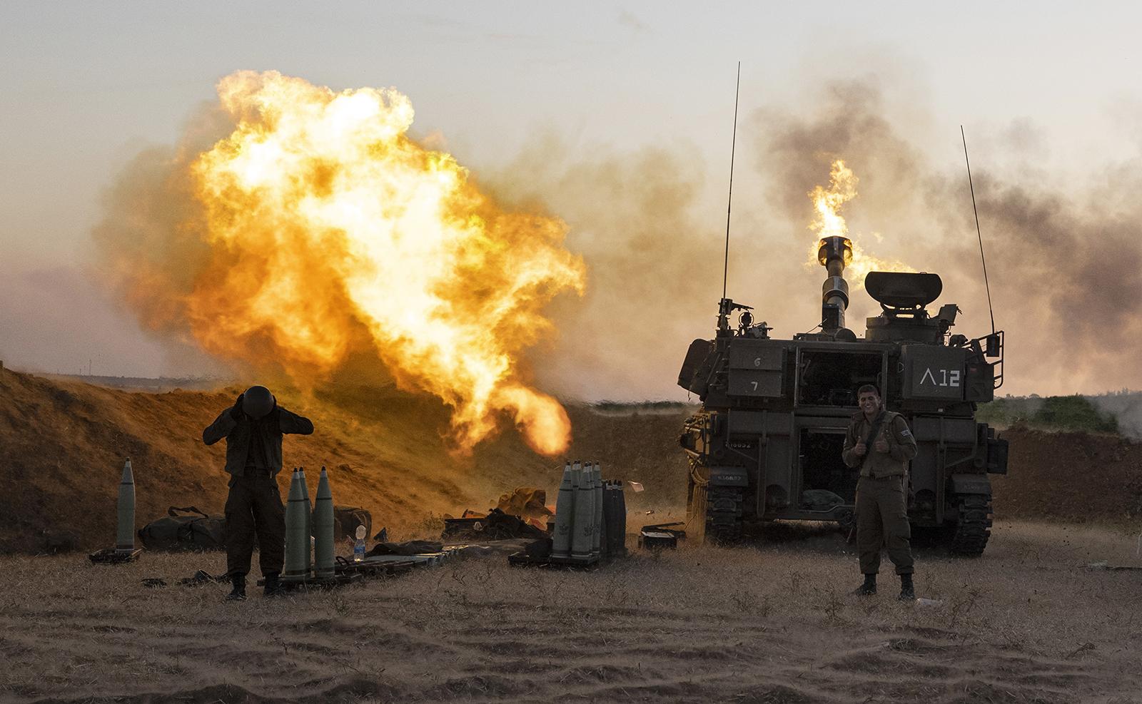 An Israeli artillery unit fires shells towards targets in Gaza Strip, at the Israeli Gaza border, Wednesday, May 19, 2021. AP