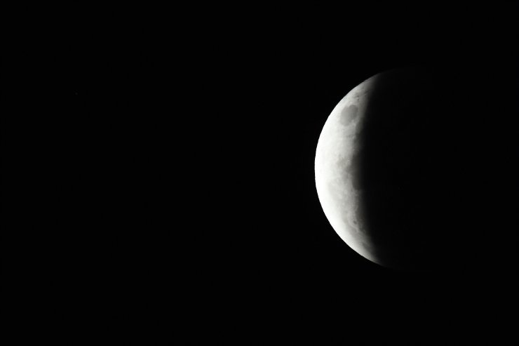 The full moon is seen during the partial eclipse in Sydney on May 26, 2021 as stargazers across the Pacific are casting their eyes skyward to witness a rare 'Super Blood Moon'. AFP