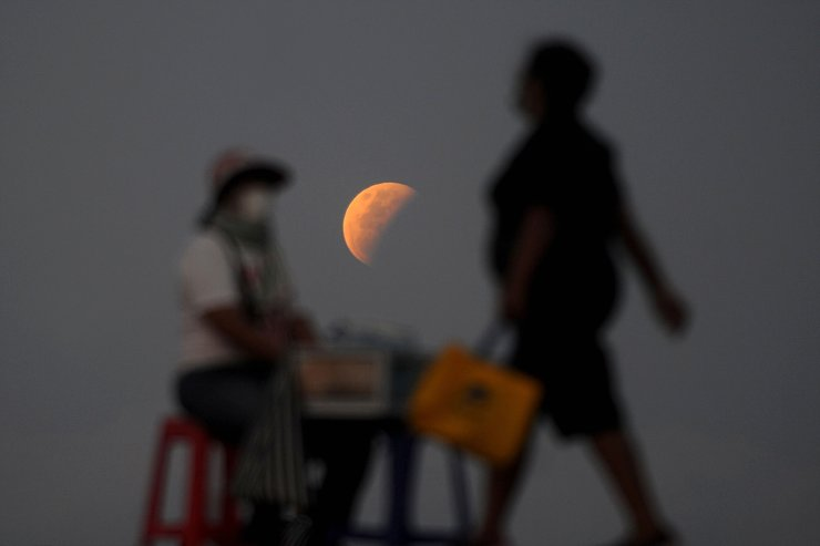 The moon is pictured from Sanur beach near Denpasar on Indonesia resort island of Bali on May 26, 2021, during a total lunar eclipse as stargazers across the Pacific are casting their eyes skyward to witness a rare 'Super Blood Moon'.  AFP
