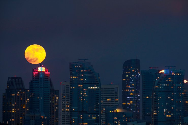 The supermoon rises over Maslak, the economic center of Istanbul,Wednesday, May 26, 2021. AP
