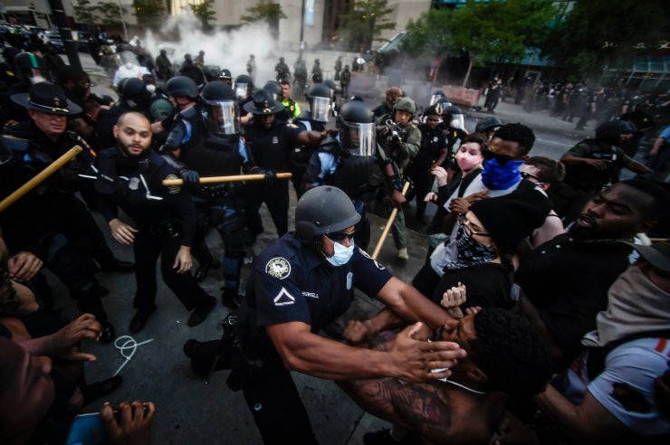 Police officers and protesters clash near CNN Center, May 29, 2020, in Atlanta, in response to George Floyd's death. The protest started peacefully earlier in the day before demonstrators clashed with police. The image was part of a series of photographs by The Associated Press that won the 2021 Pulitzer Prize for breaking news photography. AP