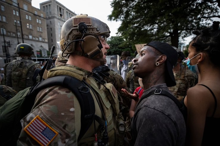 A demonstrator stares at a National Guard solider as protests continue over the death of George Floyd, June 3, 2020, near the White House in Washington, D.C. The image was part of a series of photographs by The Associated Press that won the 2021 Pulitzer Prize for breaking news photography. AP